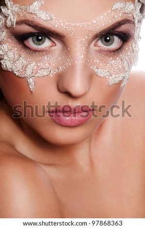 sexy woman with white mask on face, creative face art - stock photo