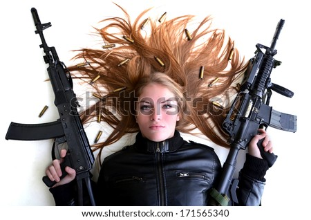Sexy woman woman with a gun - stock photo