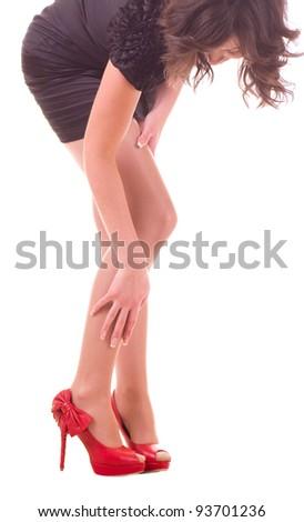 Sexy womanish leg in black shoe isolated on white background. - stock photo