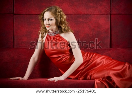 sexy women in red dress on red background