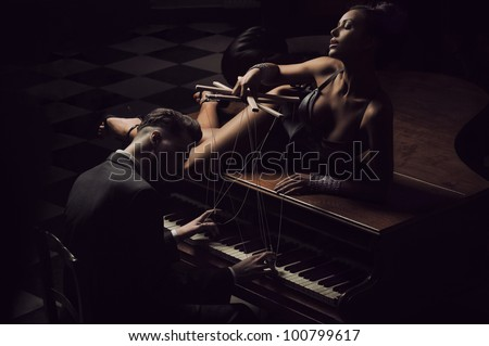 Sexy women lying in the piano