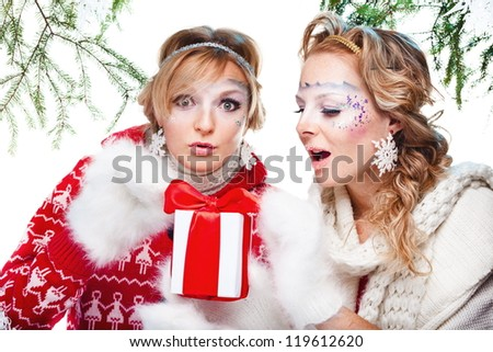 sexy women with present wrapped in white paper, isolated on white - stock photo