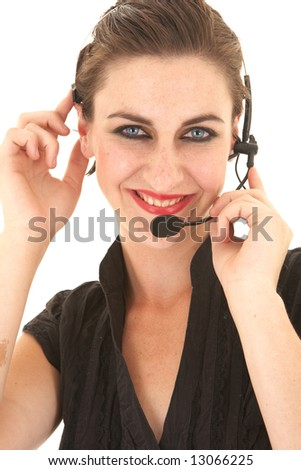 Sexy young adult Caucasian businesswoman in a tight black sexy blouse on a white background with a telephone headset