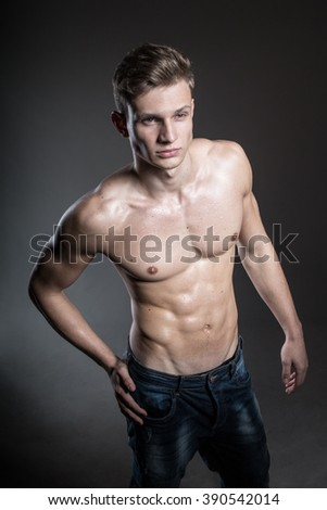 Sexy young and handsome men with muscular chest posing in studio