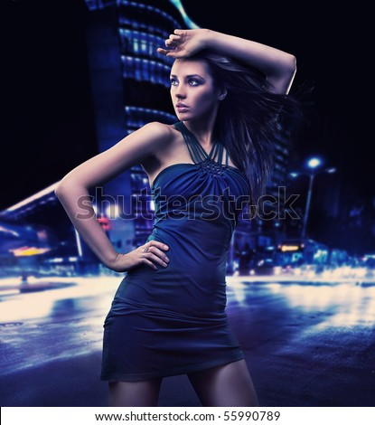 Sexy young beauty posing over night city background - stock photo