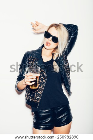 Sexy young blond woman drinking beer, not isolated on white background - stock photo