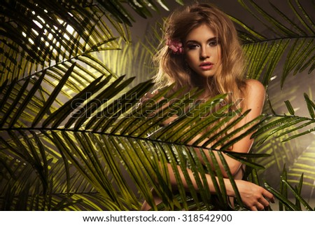 Sexy young blonde beauty in a rain forest  - stock photo