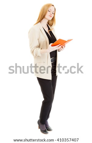 sexy young blonde lass wearing a black overalls, jacket and sandals reads a book