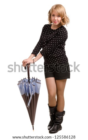 Sexy young blonde woman posing with an umbrella in a stylish modern miniskirt and boots isolated on a white background - stock photo