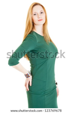 sexy young blonde woman wearing a green dress - stock photo