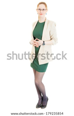 sexy young blonde woman wearing a green dress, jacket, black panti-tights and sandals - stock photo