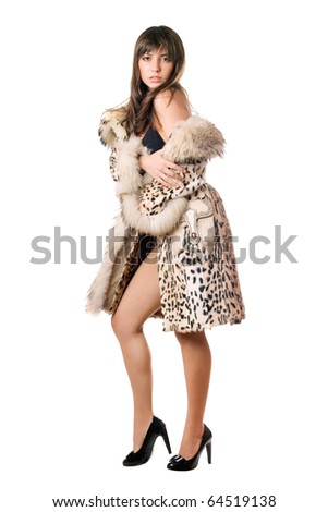 Sexy young brunette posing in leopard coat. Isolated on white