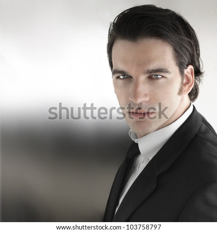 Sexy young businessman against modern background