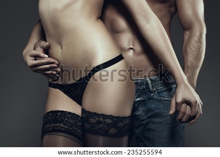 Sexy young couple body at night, holding hands, closeup - stock photo