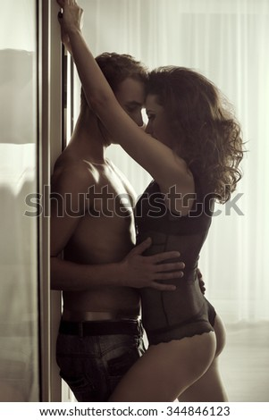 Sexy young couple hugging