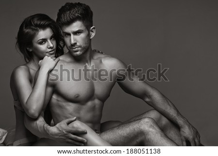 Sexy young couple in a bed - stock photo