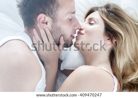 Sexy young couple kissing passionately each other
