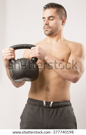 Sexy Young fashion sport man, fitness muscle model guy making push ups exercise over white background. Sport fitness body-bulding musculation weight healthy man