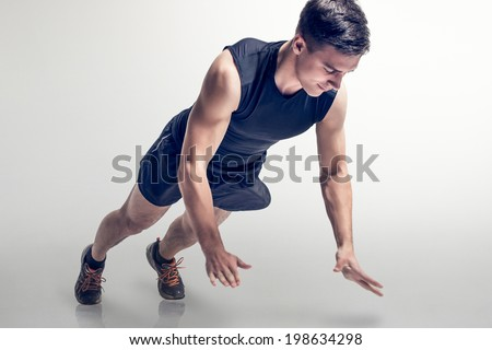 Sexy Young fashion sport muscle man, fitness model guy making push ups exercise. - stock photo
