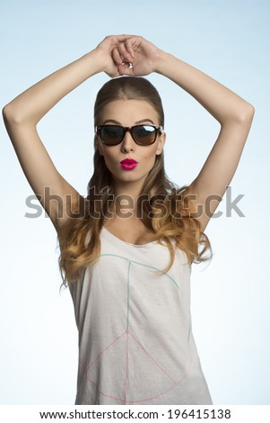 sexy young female posing with fashion sunglasses and casual style in summertime  - stock photo