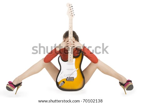 Sexy young female posing with guitar over white - stock photo