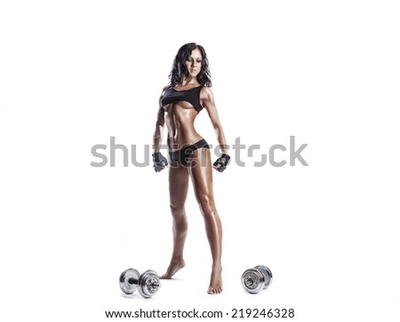sexy young fitness girl doing workout with dumbbells isolated over white. Fitness woman in sport wear with perfect fitness body workout  - stock photo