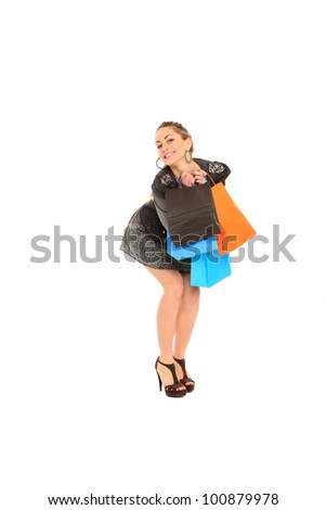 sexy young girl holding shopping bags isolated on a white background