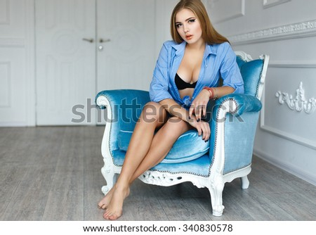 Sexy young girl in a black bra and blue shorts - stock photo