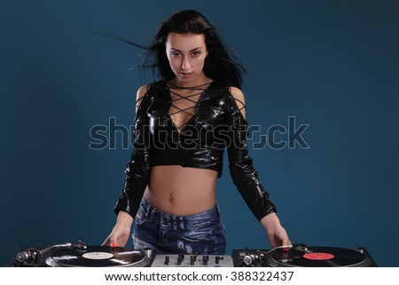 Sexy young girl posing at vinyl record players