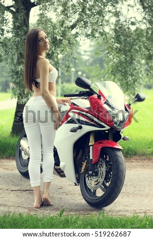 Sexy young girl with a sports motorcycle