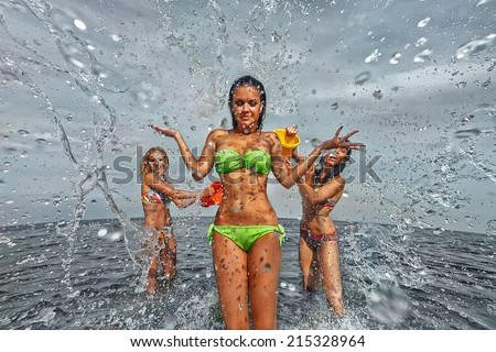 Sexy young girls on the beach have fun and laughing - stock photo