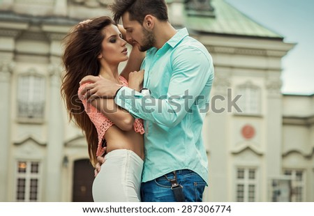 Sexy young kissing couple in love - stock photo