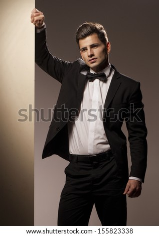 Sexy young man in suit - stock photo