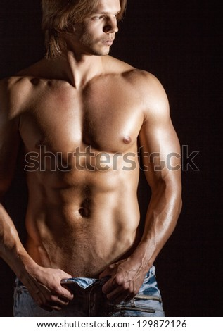 Sexy young man on a dark background