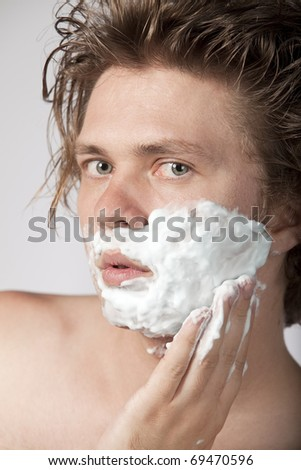 Sexy young man shaving with razor. High resolution image. See more in my portfolio