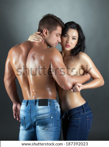 Sexy young married couple posing at camera