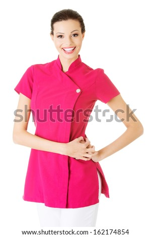 Sexy young masseuse in pink uniform. Isolated on white.  - stock photo