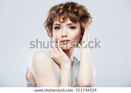 Sexy young model close up portrait. Short curly hair.