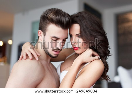 Sexy young naked couple at home foreplay, sensuality - stock photo