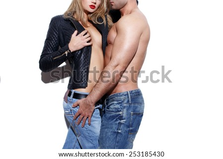 Sexy young naked fashionable couple body at white wall - stock photo