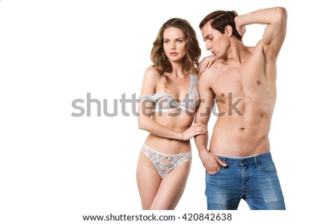 Sexy young passionate couple isolated on white background.