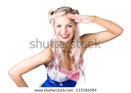 Sexy young pin-up woman in retro sailor outfit saluting, white background - stock photo