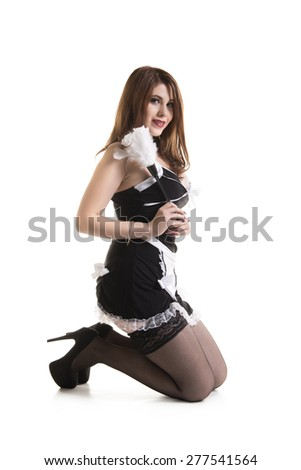 Sexy Young Pinup Maid Kneeling On White Background
