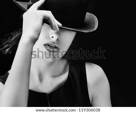 Sexy young pretty retro / vintage woman with a hat - picture in black and white - stock photo