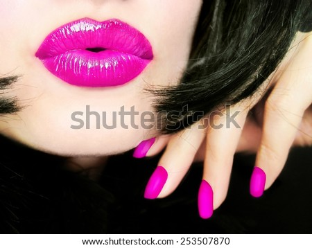 Sexy young pretty woman with pink lips makeup sending a kiss  - stock photo