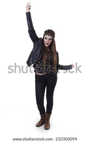 Sexy young rebellious rocker punk woman in leather jacket gesturing rock on isolated on white - stock photo