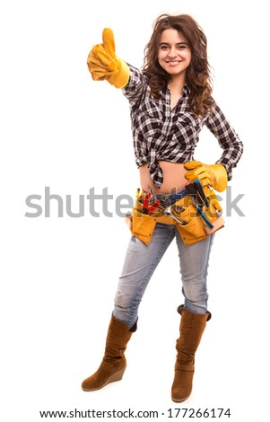 Sexy young woman construction worker signaling ok
