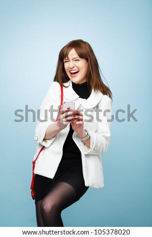 sexy young woman fashion model laughing on mobile phone