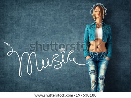Sexy young woman in a trendy clothes on a grunge background. Musical background - stock photo