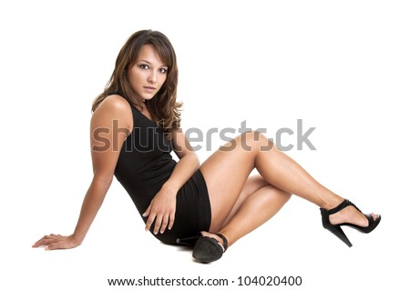 Sexy young woman in black dress isolated in white